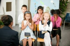 Kids praying at Sunday School
